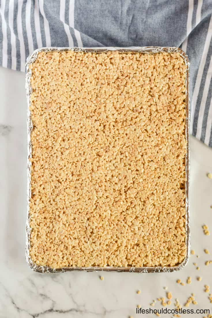 Feed a crowd with this large batch of Sheet Pan Rice Krispie Treats. Bulk recipe is perfect for potlucks, parties, and bake sales.