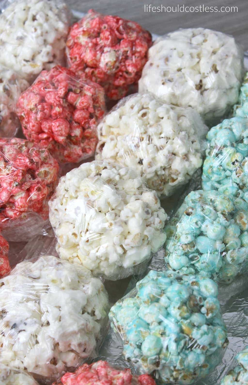 Red White and Blue Patriotic Popcorn Balls. #summertime #patriotic #dessert {lifeshouldcostless.com}