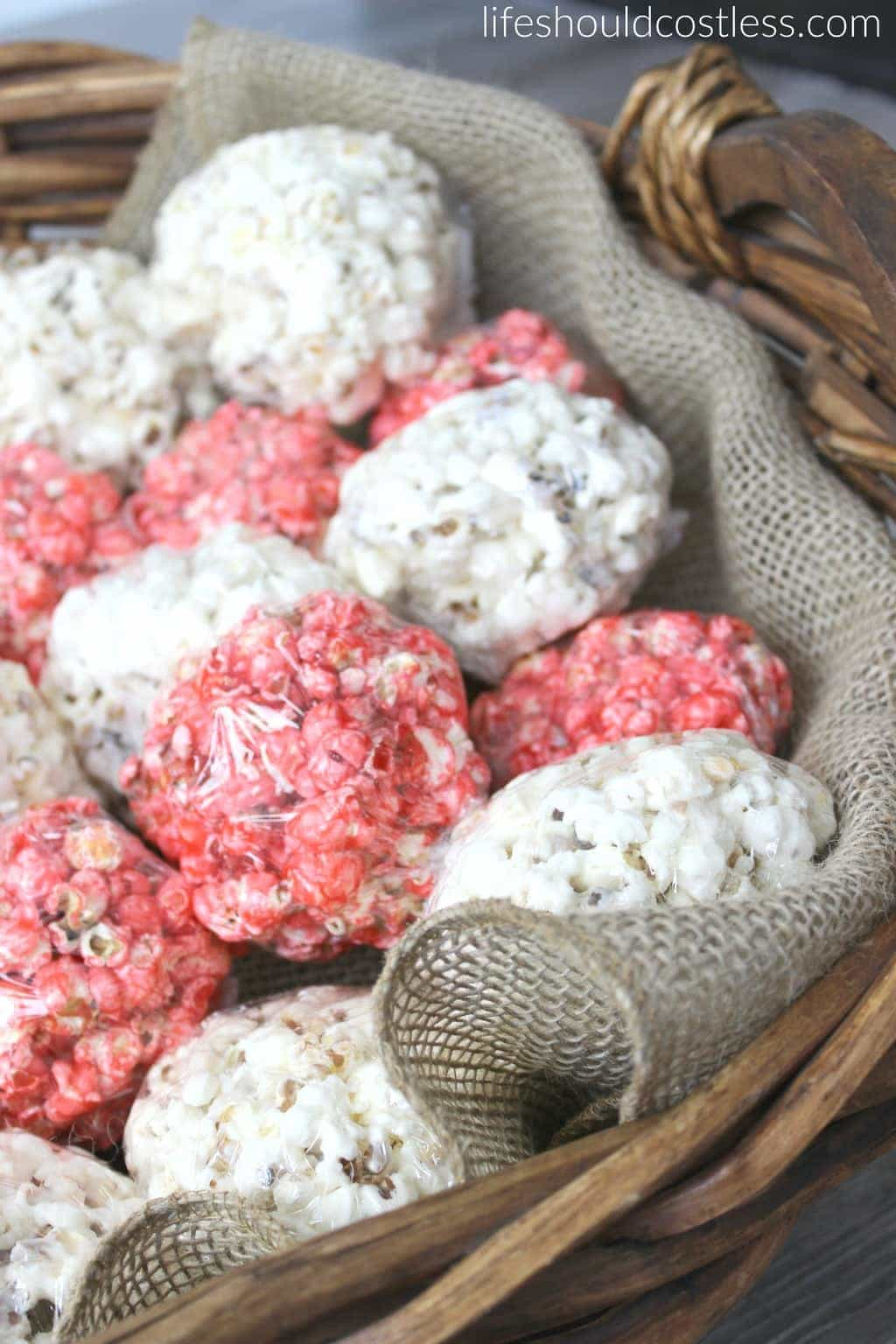 Red white and blue popcorn balls in cute large basket with burlap liner. {lifeshouldcostless.com}