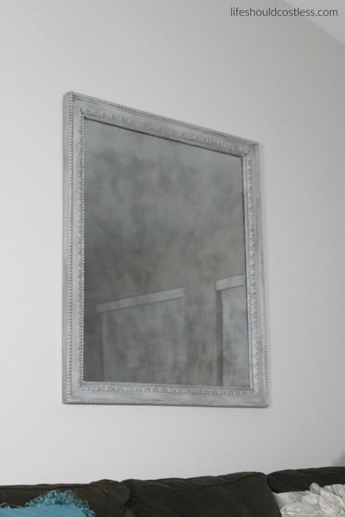 Huge print in frame turned faux antique mirror. After. Full mirror.