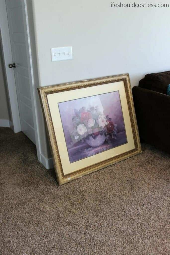 Huge print in frame turned faux antique mirror. Before