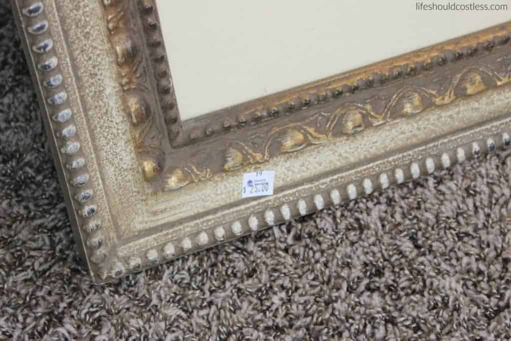 Huge print in frame turned faux antique mirror. Before with price-tag.