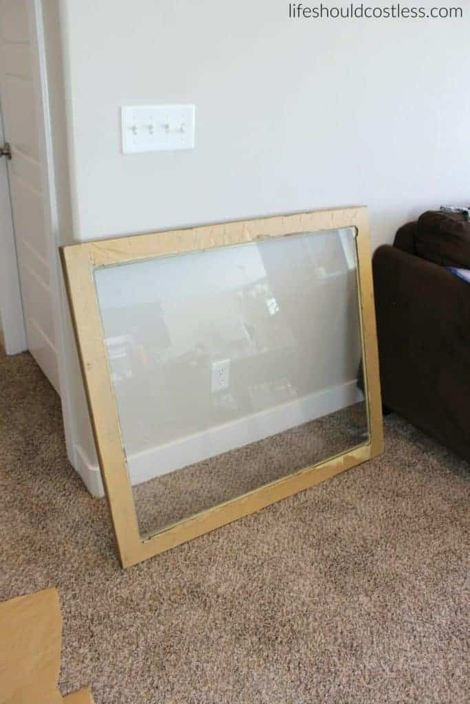 Huge print in frame turned faux antique mirror. Glass in frame.