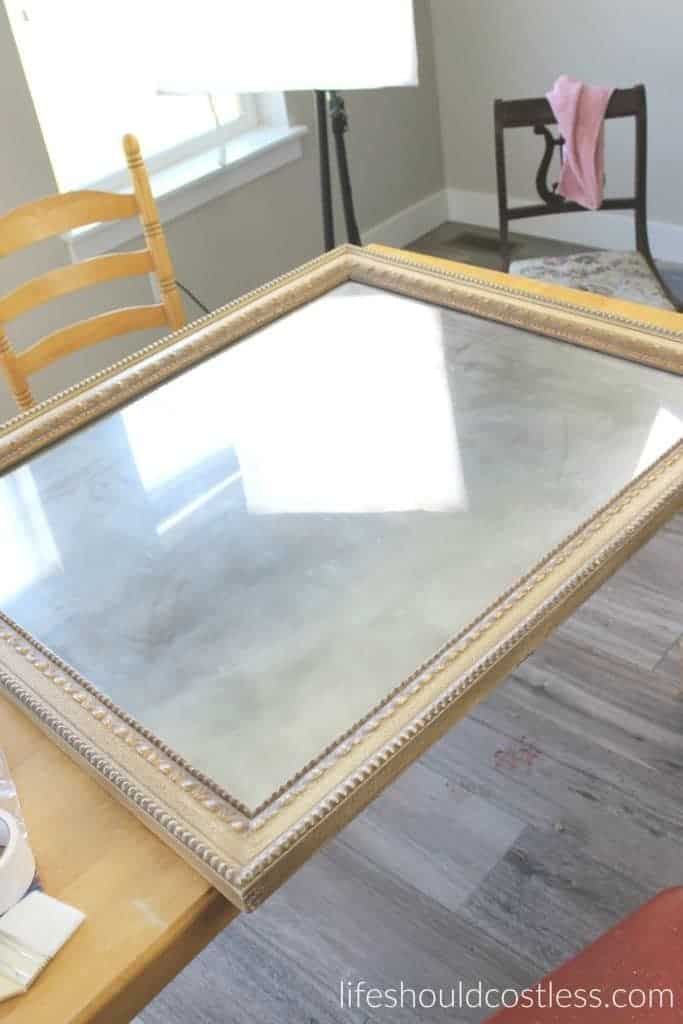 Huge print in frame turned faux antique mirror. The mirror was done, now it's time to paint the frame.
