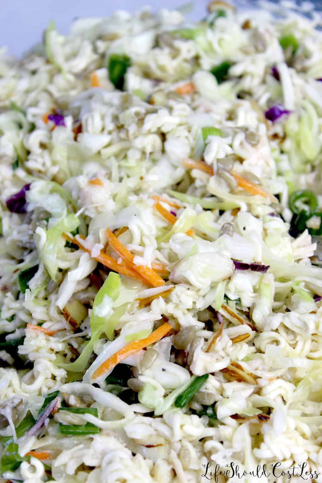 How to make oriental chicken salad with top ramen noodles and coleslaw.