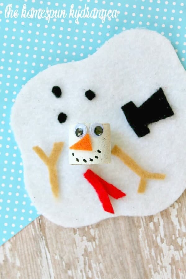 Melted-Snowman-Wine-Cork-Craft-for-Kids snowman crafts for kids