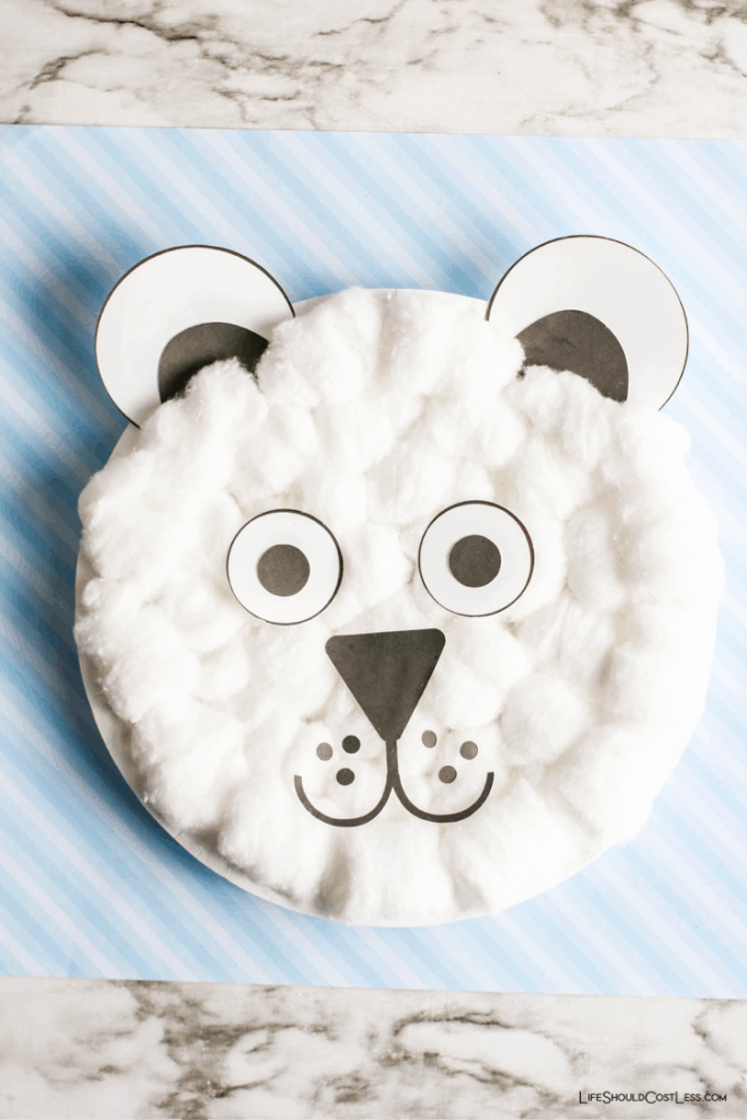 Polar bear paper plate kids craft idea for winter time. lifeshouldcostless.com