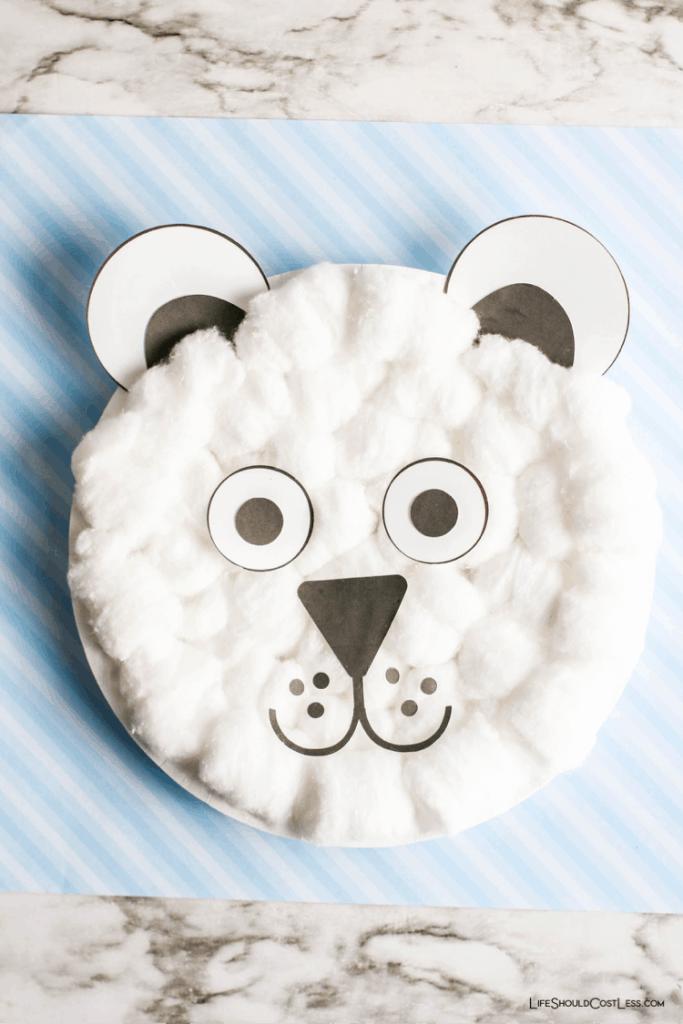 Polar bear paper plate kids craft idea for winter time. lifeshouldcostless.com